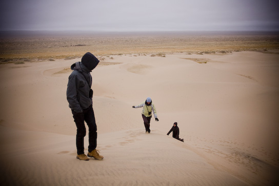 Richard, Arnika and Tina climbing the dunes before the blizzard.