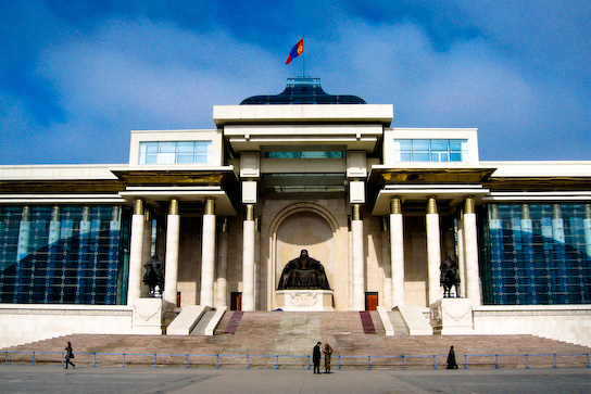 A Chinggis Khaan statue garding the Parliament House at Sukhbaatar Square.