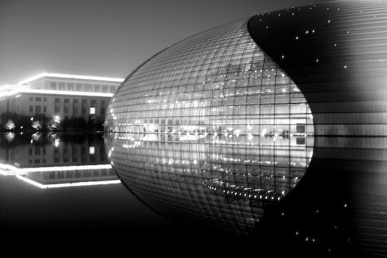 National Theater at night reflected in the surroudning pool.