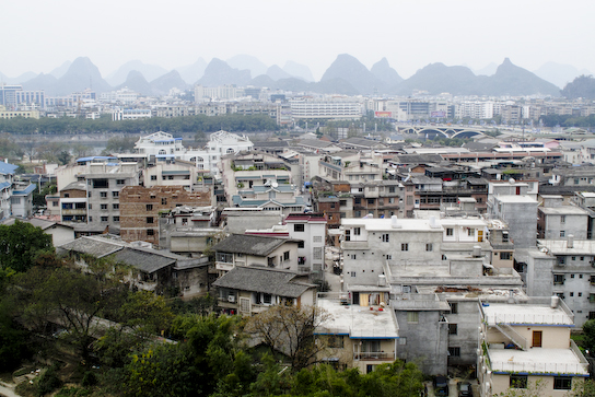 """Guilin with the surrounding linestone """"hills""""."""