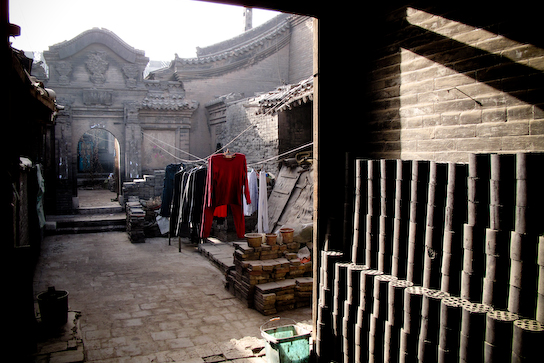 Typical courtyard - with coal cyilanders for heating.