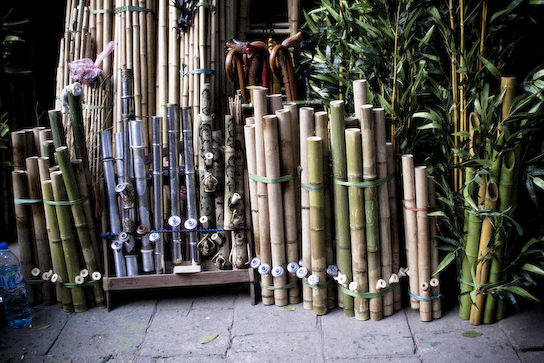 Bamboo being turned into pipes.