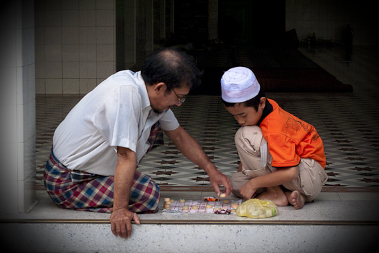 Father and son making the mosque of it.